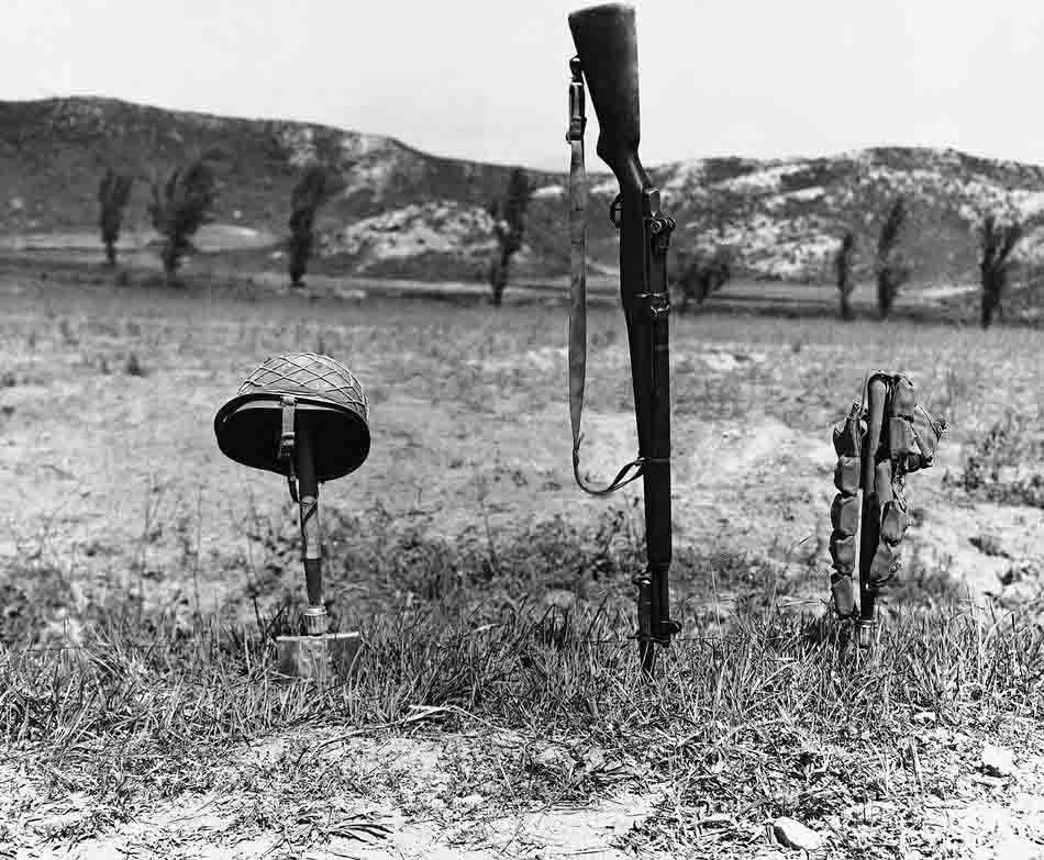 His Helmet, rifle and ammunition belt mark spot where an unidentified U.S. soldier was killed in battle on the Korean front on June 24, 1951. (AP Photo)