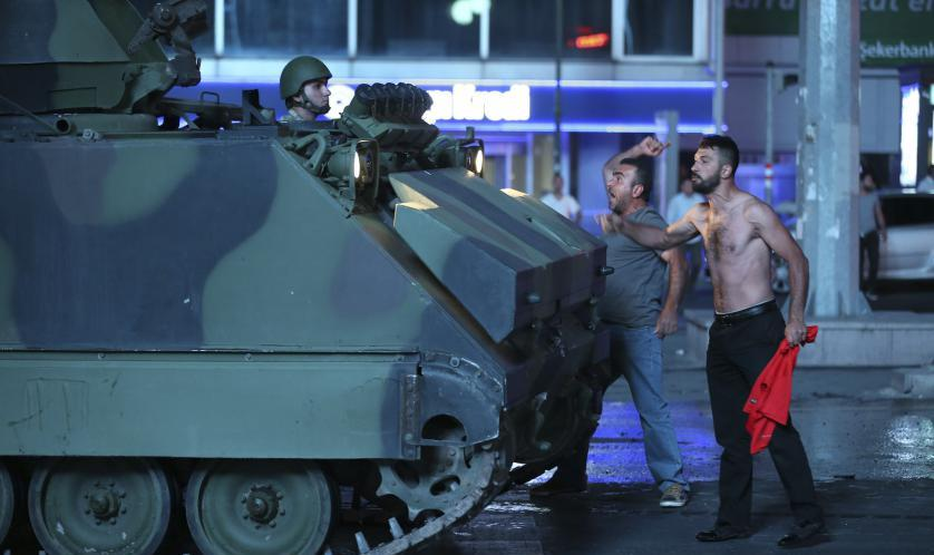 ANKARA, TURKEY - JULY 16 : People react against uprising attempt from within the army in Ankara, Turkey on July 16, 2016. (Photo by Sinan Yiter/Anadolu Agency/Getty Images)