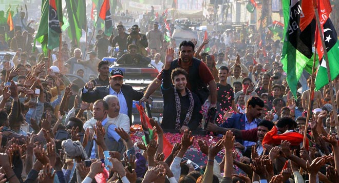 Px15-068 SUJAWAL: Nov15 - Chairman PPP Bilawal Bhutto Zardari waves to supporters as he leads a rally of election campaing ahead of local government elections. ONLINE PHOTO