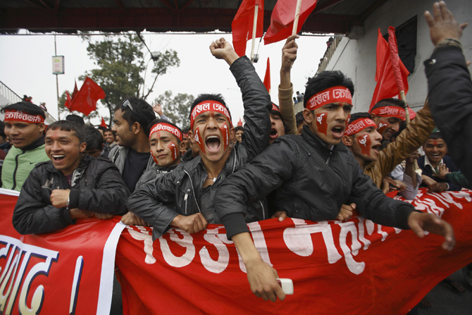 """Supporters of Unified Communist Party of Nepal (UCPN-Maoist) participate during a rally marking the 17th anniversary of the """"People's War"""" in Kathmandu February 13, 2012. According to local media, thousands of communist supporters gathered for a mass meeting at the Open Air Theatre. The UCPN-Maoist started the war on February 13, 1996 demanding for the end of the monarchy, as well as for an election to the Constituent Assembly. REUTERS/Navesh Chitrakar (NEPAL - Tags: POLITICS CIVIL UNREST ANNIVERSARY)"""