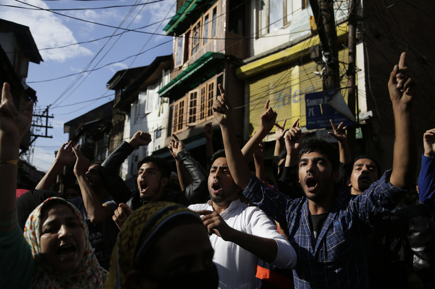 Kashmiri people shout pro freedom slogans during a protest march in Srinagar, Indian controlled Kashmir, Friday, Aug. 26, 2016. Curfew and protests have continued across the valley amidst outrage over the killing of a top rebel leader by Indian troops in early July, 2016. (AP Photo/Mukhtar Khan)